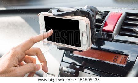 mobile phone and transportation concept - Car panel mobile phone holder device with woman using on car driving