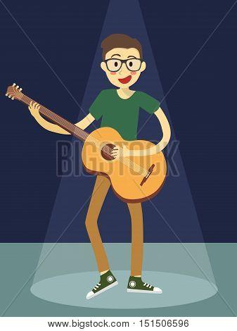 Man_plays_guitar_in_blue_spotlight