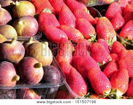 Fresh figs and strawberry on bazaar in Tel Aviv IsraelJanuary 7 2011