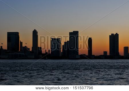 New Jersey Skyline Silhouette at dusk across the Hudson River in New York City.