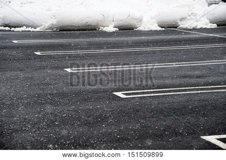 close up on empty parking lot with snow removed