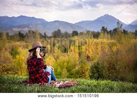 Woman With Camera At Autumn Picnic