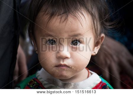 Sapa, Vietnam-September 2016: The innocence of Munk kid in Sapa, Vietnam. Kids in Sapa live in prverty and lacks of healthcare.