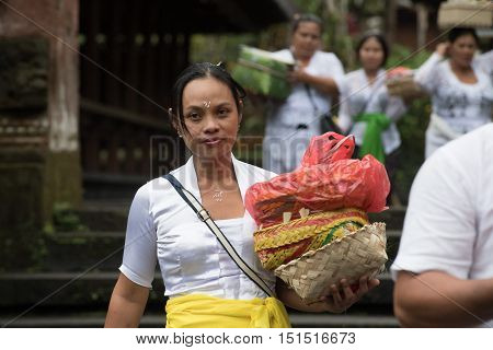 Bali, Indonesia - August 14, 2016 - Balinese Monk And Worshipper At The Temple For Full Moon Celebra