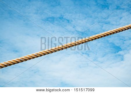 Rope is against blue sky background. Copy space.