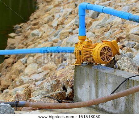 small yellow clear water surface pump being used at a new pond near Songkhla, Thailand