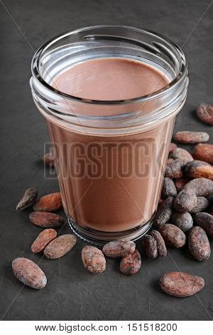 Chocolate Milk And Pieces Of Chocolate Bar And Cocoa Beans