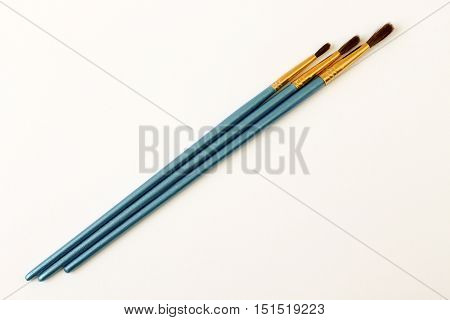 Paint brushes with gouache. School accessories. Preparation for school.