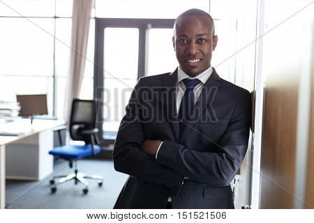 African American Business Man standing proudly in front of his office