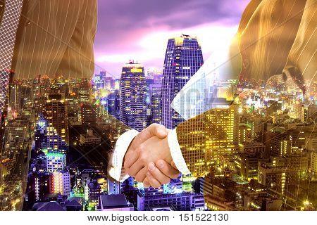 Hand shake business success on city background background illustration.