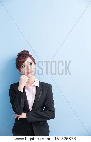 business woman is thinking something with isolated on blue background asian