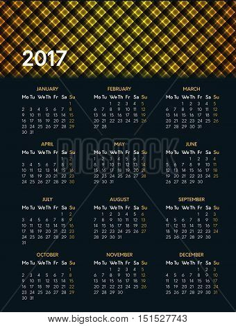Vector calendar for 2017 year on dark background with shiny yellow pattern in header. Week starts on monday
