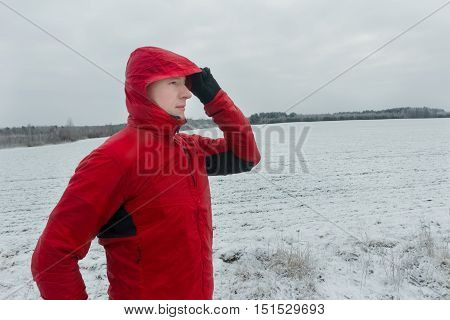 Portrait of man wearing protective winter running jacket during his training session outdoors