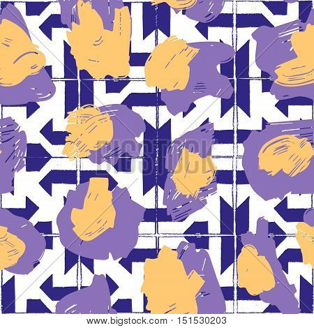 The texture of the leopard spots. Leopard pattern for textiles. Yellow-purple spots on the background with blue geometric pattern