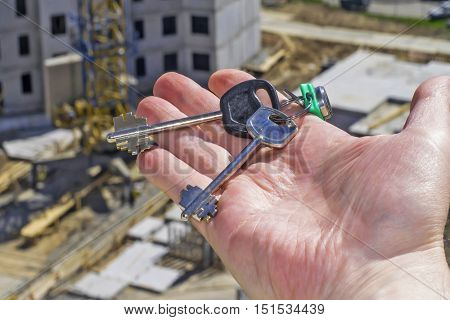 Keys from new apartments in the background construction .