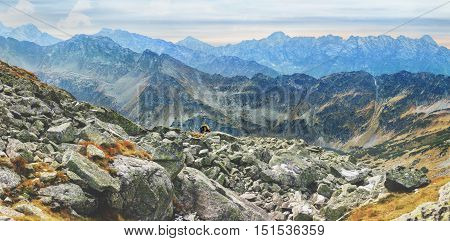 lonely tourist enjoys stunning panorama of Mieguszowiecki Grand Peak from Goat Peak, High Tatras, Zakopane, Poland