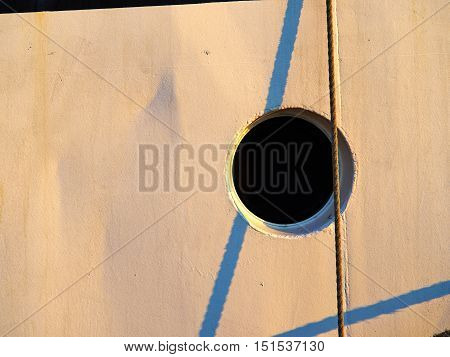 Round circular shape boat ship window porthole on white wooden wall great boating background image