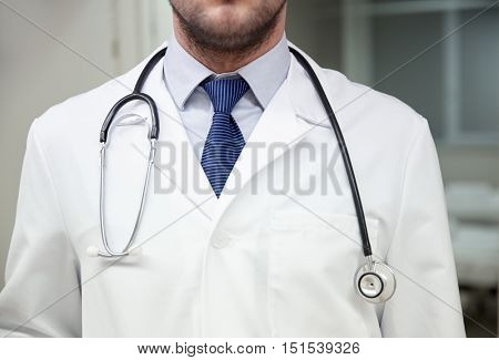 healthcare, profession, people and medicine concept - close up of doctor in white coat with stethoscope at hospital