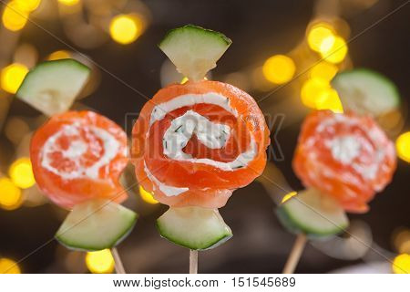Smoked salmon rolls with cream cheese and cucumber candy
