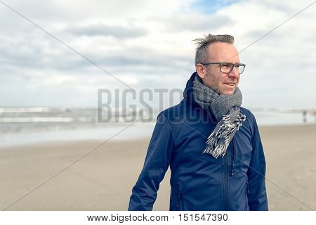 Irritated Middle-aged Man On An Autumn Beach