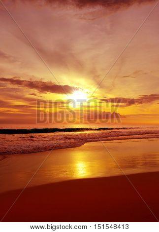 Bright red sunrise over the sea