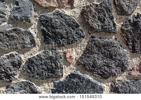Closeup of volcanic stone wall in Santorini Greece