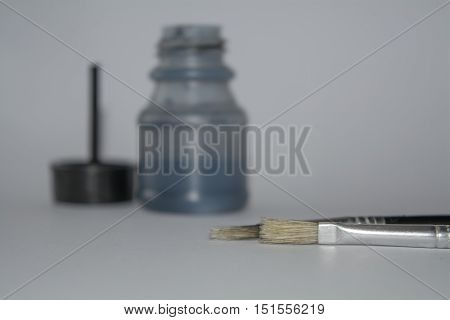 Ink bottle and brush isolated on the white background