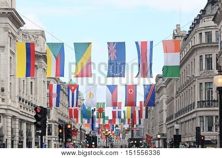 LONDON UK - June 22: Regent Street with a stunning display of flags representing every competing nation in the forthcoming sports event in London UK - June 22 2012; The capital's most famous shopping streets laid with special greeting to the 2012 Olympics