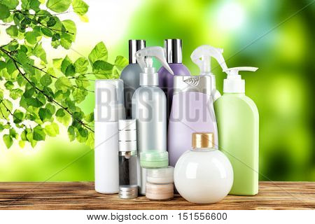 Set of body care products on green natural background