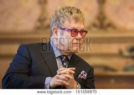 KIEV UKRAINE - Sep 12 2015: World-famous musician composer and singer Elton John well-known in world for his charitable activity in fight against AIDS against his meeting with President of Ukraine Petro Poroshenko