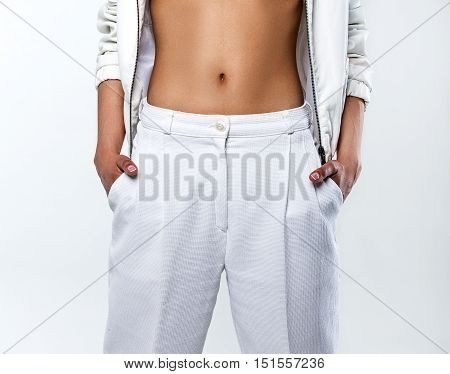 female white trousers in a grey background