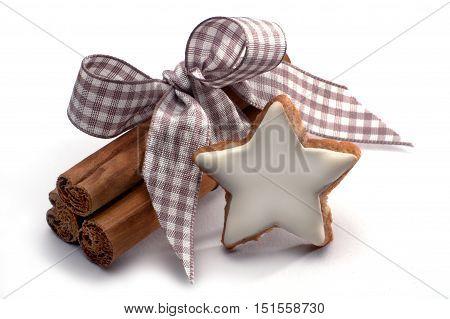 Cinnamon star and cinnamon sticks isolated on white