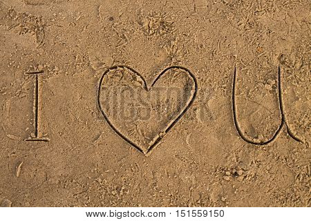 I Love U sign on the wet sand beach