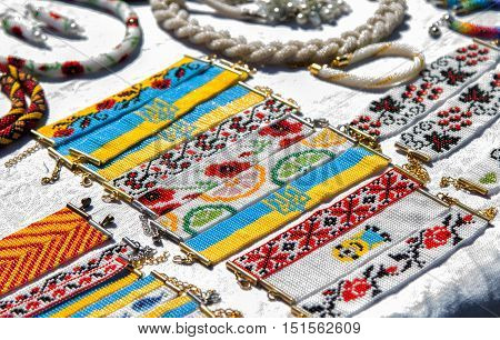 Zaporizhia/Ukraine- September 17, 2016: Family festival of homemade pickled canned vegetables and preserves. Stand with handmade bracelets, made of colorful beads, with Ukrainian symbolic, flowers and fruits ornaments.
