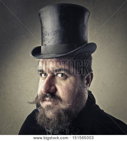 Man with mustache wearing a black cylinder