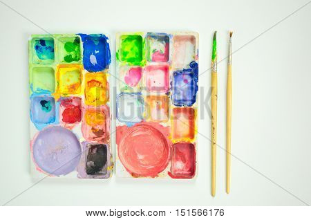 Palette and Paintbrush.The color palette used for color Mixing colors for painting.