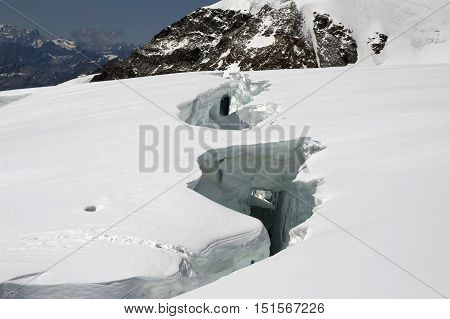 big crevasse on lys glacier on monte rosa
