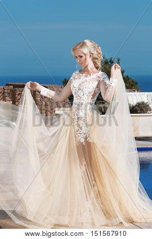 Happy Blond Bride In Fashion Wedding Dress With Blowing Beige Skirt, Outdoor Summer Portrait. Slim Y