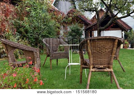 Rattan Chairs And White Table