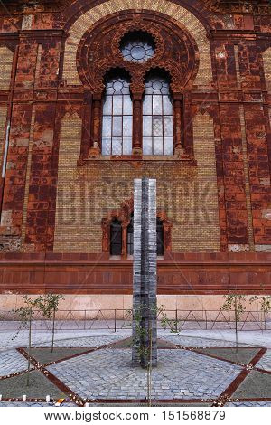 Uzhgorod Ukraine - October 9 2016: A monument to local victims of the Holocaust after the opening of the square near the former synagogue. A monument to local victims of the Holocaust in Uzhgorod is made from metal plates in the form of a Star of David it