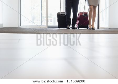 Low section of business people standing at doorway in convention center