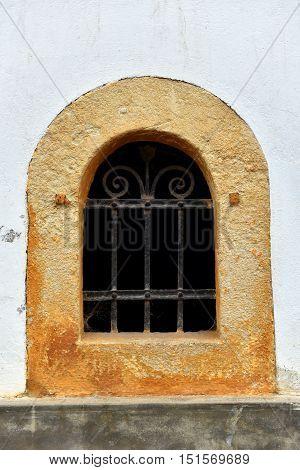 Forged Metal Lattice On Cellar Window