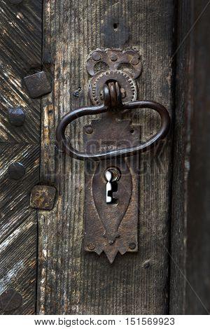 Ornamental Vintage Iron Door Handle On Wooden Door