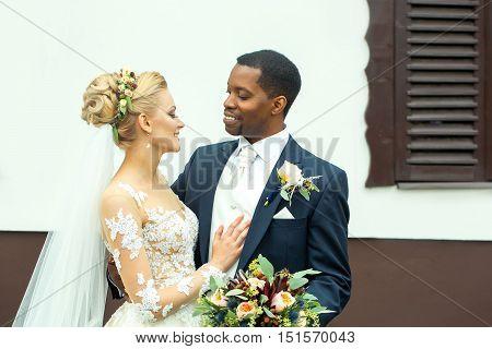 Young Groom Hugs Beautiful Bride