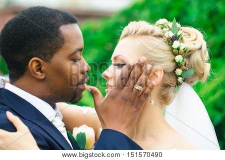 Happy Newlyweds Hug Outdoors