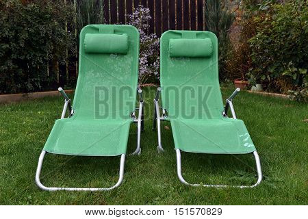 Green Deck Chairs In The Garden. Relaxing Concept