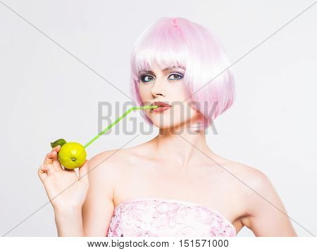 Pretty Girl In Pink Wig With Green Apple