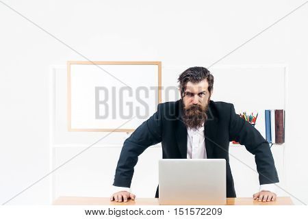 Businessman Learning Over Table