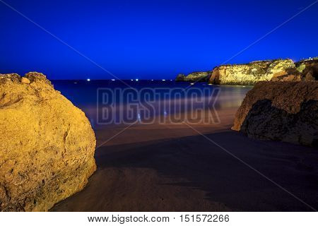 Lagos Beach with cliffs and fishermen's boat Algarve Portugal