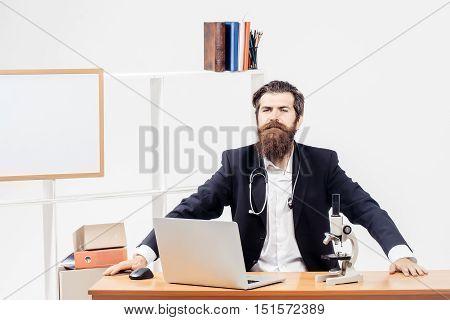 Workman Sitting At Desk